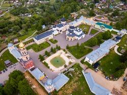Aerial view of architectural ensemble of Orthodox Voznesenskaya Davidovskaya poustinia, Moscow region, Russia