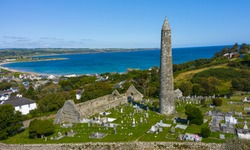 Aerial view of Ardmore Round Tower, Built in the 12h century, the tower stand tall over looking the coastal village of Ardmore.