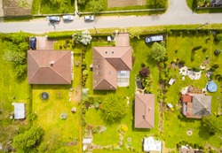 Aerial view of area for pleasant living in suburban district. Houses with beautiful gardens.