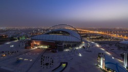 Aerial view of Aspire Zone from top night to day timelapse in Doha. Traffic on the road. Foggy weather