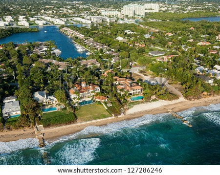aerial view of atlantic ocean shoreline and luxury homes at boynton beach in palm beach county in florida, winter 2013