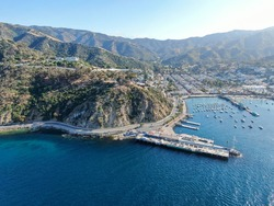 Aerial view of Avalon downtown and bay with boats in Santa Catalina Island, famous tourist attraction in Southern California, USA