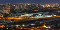 Aerial view of Bang Sue Grand Station and office buildings at twilight. New central station of Bangkok Thailand