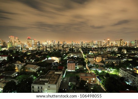 Aerial view of Bangkok cityscape of village, condominiums, and high towers at night