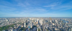 Aerial view of Bangkok Downtown Skyline. Thailand. Financial district and business centers in smart urban city in Asia. Skyscraper and high-rise buildings at noon with blue sky.