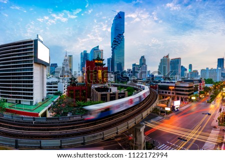 Aerial view of Bangkok modern office buildings and condominium in Bangkok city downtown with blue sky and clouds at Bangkok, Thailand. BTS skytrain