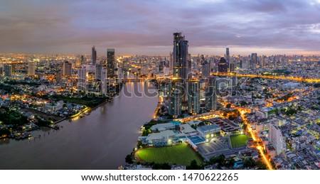 Aerial view of Bangkok modern office buildings, condominium in Bangkok city downtown with sunset sky , Bangkok , Thailand.