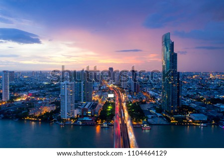 Aerial view of Bangkok modern office buildings, condominium, living place in Bangkok city downtown with sunset scenery, Bangkok is the most populated city in Southeast Asia.Bangkok , Thailand