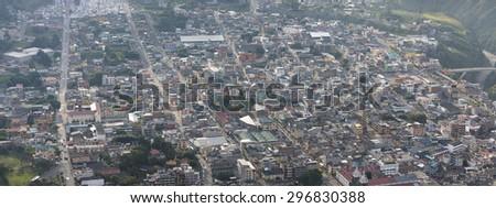 Aerial view of Banos de Agua Santa, a small city in the Andean highlands of Ecuador under the smoke of volcano Tungurahua. Ecuador 2015