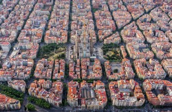 Aerial view of Barcelona Eixample residencial district, Sagrada familia, typical urban squares, Spain. Late afternoon soft light