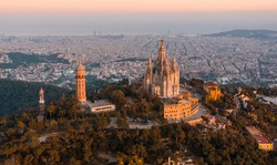 Aerial view of Barcelona skyline with Sagrat Cor temple during sunset, Catalonia, Spain