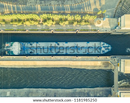 aerial view of barge ship on the river in gateway dock near dam