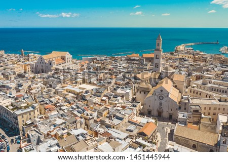 "Aerial view of Bari old town. On the right there is Bari Cathedral (Saint Sabino), on the left there is ""San Nicola Basilica"", Bari second Cathedral. These churches were built during middle ages."