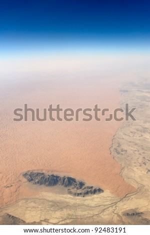 Aerial view of barren desert and rocks