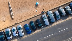 Aerial view of beach side by the road with parked cars on a side, Hove, East Sussex, UK