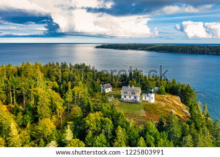 Aerial view of Bear Island Lighhouse. Bear Island and the Bear Island Lighthouse are located in the community of Cranberry Isles, in Acadia National Park, Maine.