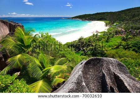 Aerial view of beautiful Grand Anse beach on La Digue island in Seychelles - stock photo