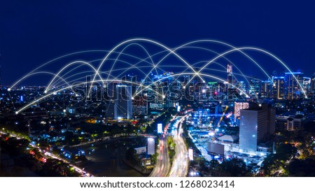 Aerial view of beautiful Jakarta cityscape with connection network at night time #1268023414
