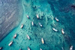 Aerial view of beautiful ocean seascape with fishing boats in the coast