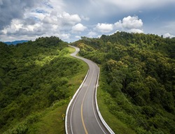 Aerial view of beautiful steep curved road (look like number 3) on the high mountain in Nan province, Thailand. An iconic tourist attraction place on the way to Bo Kluea (means salt well) district.