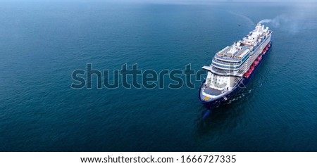 Aerial view of beautiful white and black cruise ship above luxury cruise in the ocean sea  concept tourism travel on holiday take a vacation time on summer.