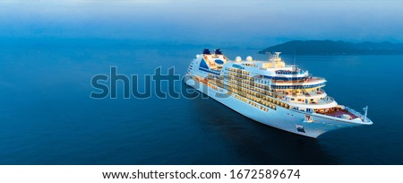 Aerial view of beautiful white cruise ship above luxury cruise in the ocean sea at early in the morning time concept smart tourism travel on holiday take a vacation time on summer.