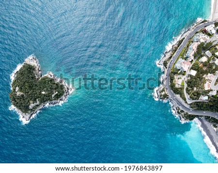 Aerial view of Bergeggi island, heart island from above, in Liguria, north Italy. Drone photography of the Ligurian coast, province of Savona with Spotorno and the island of Bergeggi.