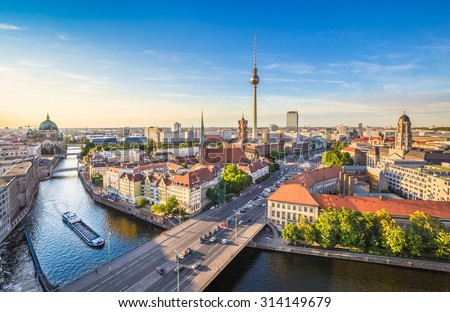 Aerial view of Berlin skyline and Spree river in beautiful evening light at sunset in summer, Germany #314149679