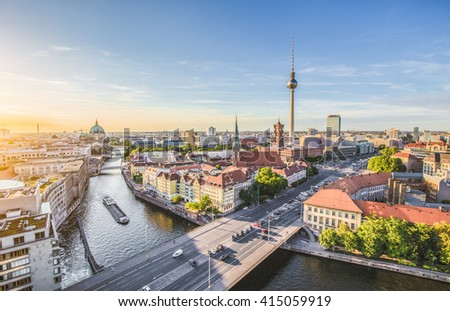 Aerial view of Berlin skyline with famous TV tower and Spree river in beautiful golden evening light with clouds at sunset with retro vintage Instagram style grunge pastel toned filter effect, Germany