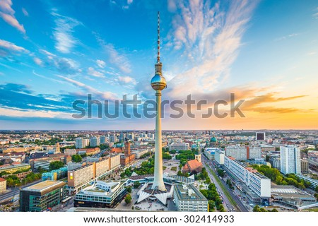 Aerial view of Berlin skyline with famous TV tower at Alexanderplatz and dramatic cloudscape at sunset, Germany #302414933