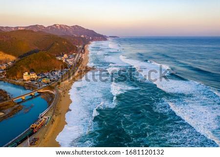 Aerial view of big waves at Jeongdongjin Beach near Gangneung-si, Korea. Stockfoto ©