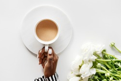 Aerial view of black woman drinks coffee