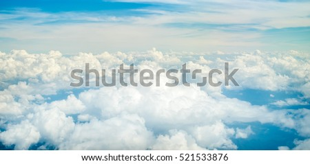 Aerial view of Blue sky and Cloud Top view from airplane window,