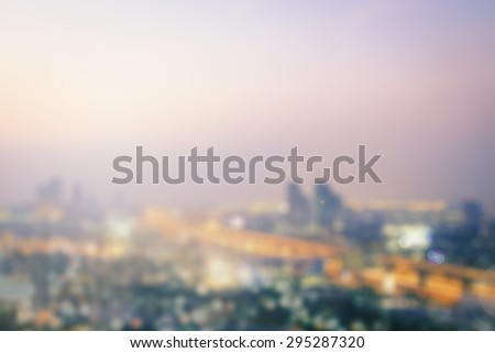 Aerial view of blur Bangkok city, Thailand background. Blurred sunset over city background with bokeh circle light. Blur background concept.