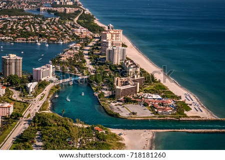 aerial view of boating inlet from atlantic ocean to intracoastal waterway at boca raton florida community