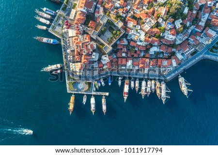 Aerial view of boats, yachts, floating ship and beautiful architecture at sunset in Marmaris, Turkey. Landscape with boats in marina bay, sea, buildings in city. Top view of harbor with sailboat.