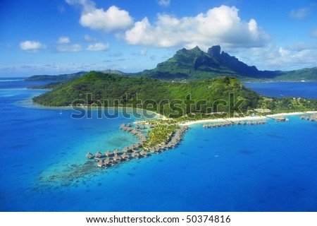Aerial View of Bora Bora with overwater Bungalows.
