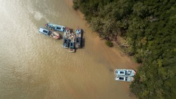 Aerial view of bunch of abandon fishing boats in a river.