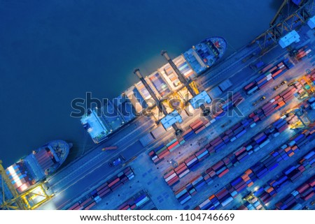Aerial view of business port with shore crane loading container in container ship in import/export and business logistics with crane and shipping port .International transportation and port concept.  #1104746669
