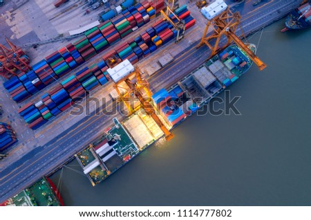 Aerial view of business port with shore crane loading container in container ship in import/export and business logistics with crane and shipping port cargo.International transportation  port concept. #1114777802