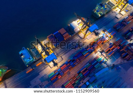 Aerial view of business port with shore crane loading container in container ship in import/export and business logistics with crane and shipping port cargo.International transportation concept.  #1152909560
