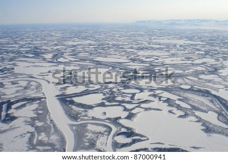 Aerial view of Canada's longest river, the Mackenzie River, empties into the Beaufort Sea, Arctic Ocean in a region known as the Mackenzie Delta. The Mackenzie Delta is the largest delta in Canada.