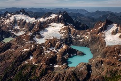 Aerial View of Canadian Rocky Mountains Landscape with Colorful Glacier Lake. Artistic Render. Taken in Woss Lake Provincial Park, Vancouver Island, British Columbia, Canada. Nature Background