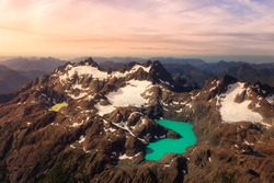 Aerial View of Canadian Rocky Mountains Landscape with Glacier Lake. Artistic Render. Sunset Sky. Woss Lake Provincial Park, Vancouver Island, British Columbia, Canada. Nature Background