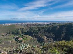 Aerial view of Capital city Las Palmas with port and atlantic ocean from Viewpoint at peak Pico de Bandama. Gran Canaria, Spain. Sunny day, blue sky.