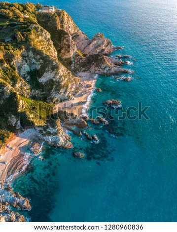 Aerial view of Capo Vaticano, Calabria, Italy. Ricadi. Lighthouse. Coast of the Gods. Promontory of the Calabrian coast at sunset. Jagged coastline, coves and beaches