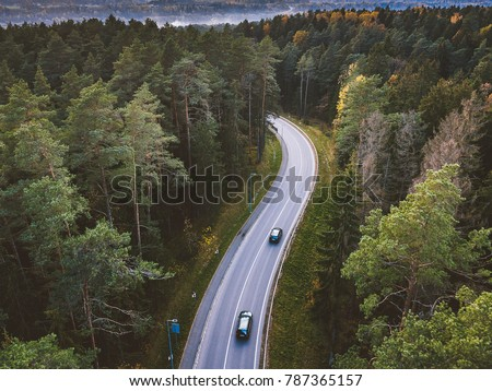 aerial view of car driving...