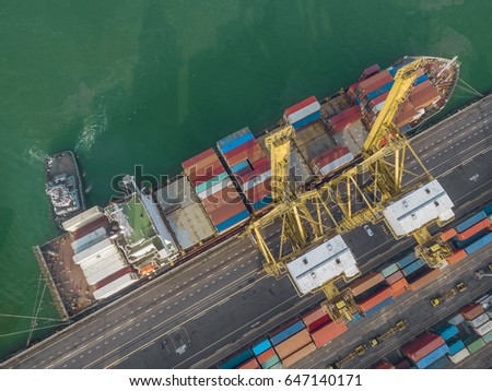Aerial view of cargo ship, cargo container in warehouse