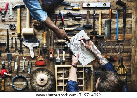 Aerial view of carpenter man listing checking tools equipment