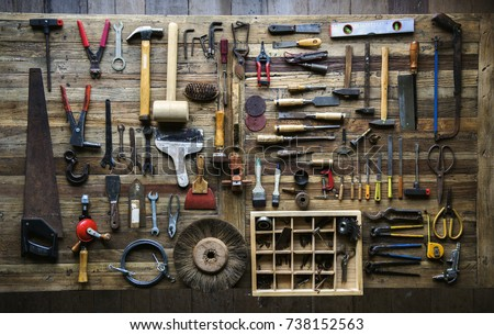 Aerial view of carpenter tools equipment set on wooden table